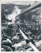 1965 Press Photo Skiers Kick Back & Relax Reflections in Window Mt Snow Vermont