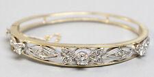 Stunning Two Tone 14K Yellow/White Gold Bangle Bracelet w/1.11ctw Diamonds