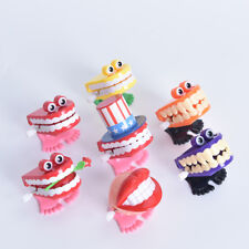 HOT FUNNY JUMPING TEETH CHATTERING SMILE TEETH SMALL WIND UP FEET TOY