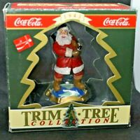 Coke Cola 1993 Christmas Ornament with Traveled Refresh Santa