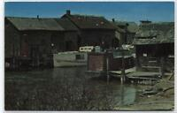 FISH TOWN~SHACKS,OLD BOAT~LELAND,MICHIGAN  POSTCARD
