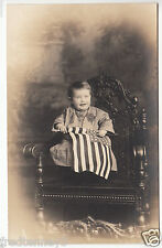 RPPC - Young Baby (Zelma Schuster) with American flag - early 1900s