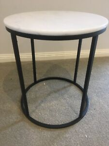Side Table. Round. Carrara marble top (1x crack). Black steel legs.