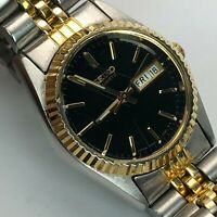 Seiko Womens 7N83-0049 Two Tone Stainless Steel Day Date Quartz Bracelet Watch
