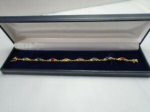STUNNING 9CT GOLD TENNIS BRACELET SET WITH  MULTI COLOURED SAPPHIRE AND DIAMONDS
