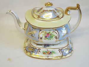 Antique Paragon Star China teapot and stand in 6121 pattern.