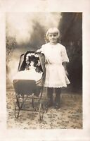 Photo Studio Real Photo Postcard Little Girl with Doll in Baby Carriage~114982