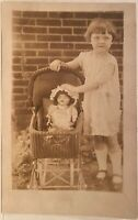Real Photo Postcard RPPC Little Girl Holds Large Doll In Wicker Doll Carriage