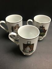 (3) Danbury Mint 1981 Norman Rockwell footed gold trim coffee mugs