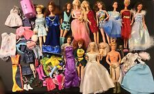 Lot of Barbie Dolls with Clothes and Accessories