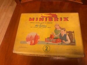 Vintage toy Minibrix building system in miniature self locking rubber bricks