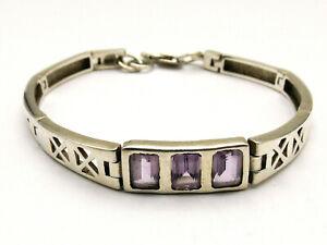 Sterling silver bracelet interesting shaped links with oblong purple stones