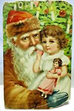 1910 POSTCARD MERRY CHRISTMAS, SANTA CLAUS WEARING BROWN,HOLDING GIRL W/ DOLL