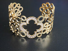 yellow gold four point four leaf clover with embedded cz stones stainless steel