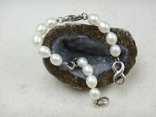Vintage IPS IMPERIAL PEARL SYNDICATE with Infinity Charms 925 Sterling Bracelet