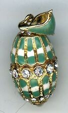 Russian Faux Egg Pendant of a decor of green embedded w/gold circulated crystals