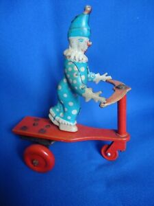 BUDAPEST CLOWN TRICYCLE ROLLER TIN TOY