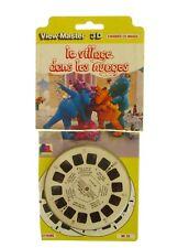 View-master - LE VILLAGE DANS LES NUAGES  3D - 3 disques - 21 photos   - 1982