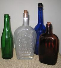 LOT OF 4 VINTAGE BOTTLES GREEN, AMBER, CLEAR AND BLUE