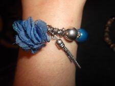 VERY UNUSUAL BRACELET ELASTICATED SILVER TONE AND BLUE BEADS WITH CHIFFON FLOWER