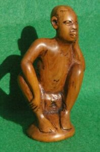 SMALL CARVED SITTING  NATIVE MALE LISTENING IN CARVED WAXED LIGHT WOOD