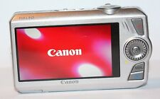 CANON IXUS 1000 HS 10.0 MP DIGITAL CAMERA + NB-9L BATTERY - FAULTY CAMERA 1428