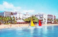 1960's A low aerial view of Moana Hotel, Waikik, surfers Hawaii