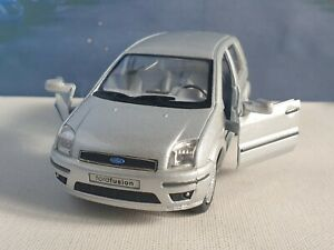 FORD FUSION in SILVER 1.32 KINSMART DIECAST FACTORY SECONDS FAULTY TOY CAR