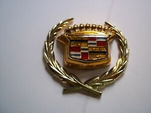 NOS NEW  80-96 Cadillac Models GOLD Trunk Lock Swing Emblem