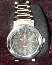 New Swiss Army Watch - round black face and silver band