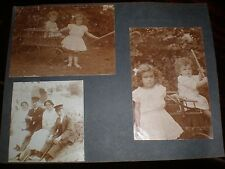 2 old photographs children and their buggy c1910s
