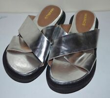 Flat (0 to 1/2 in.) Leather Mules Sandals & Flip Flops for Women