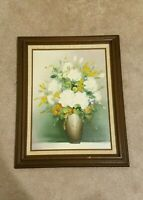 VINTAGE SIGNED FLORAL STILL LIFE OIL ON CANVAS PAINTING WITH WOOD FRAME. 12X16.