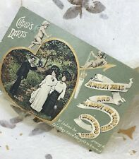 Antique Xmas Card 1906 Hand Tinted Cupids Darts Gilded Postcard Posted JWS 2816