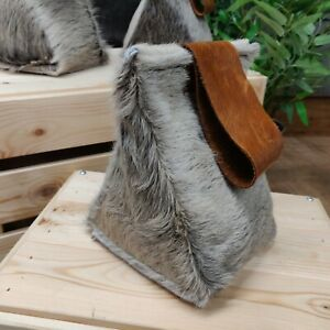 Cow hide and leather door stops in grey and brown