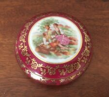 Limoges deep pink trinket box with courting couple and gold borders