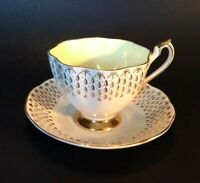 Queen Anne Pedestal Cup And Saucer - Gold & White With Yellow Interior - England