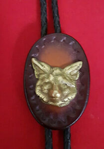 Brass Wolf/Coyote on Leather Mounting Bolo Tie with Braided Leather Tie. Superb