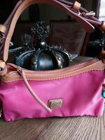 Dooney And Bourke Pink and Tan Small purse. New with certificate.