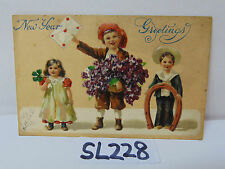 VINTAGE POSTCARD POSTED STAMP 1907 HAPPY NEW YEAR KIDS-BOY-GIRL-HORSESHOE-CUTE