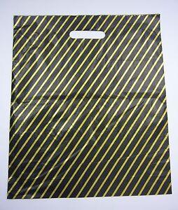 """BLACK / GOLD STRIPE CARRIER BAG 15"""" x 18"""" PACK 100"""