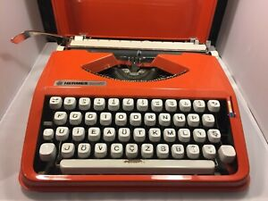 Hermes Baby Typewriter Orange Cursive with Case