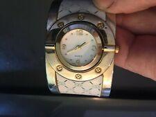 Ladies Gold Tone Bangle Bracelet Swiveling Quartz Watch