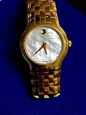 LADIES MOVADO CELESTINA GOLD PLATED WATCH. MOTHER OF PEARL DIAL SAPPHIRE CRYSTAL