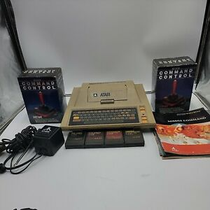ATARI 400 COMPUTER, 4 GAMES and  2 Wico Command Controllers