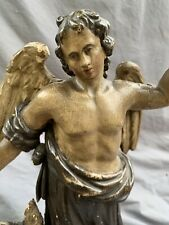 17th CENTURY OAK CARVED FIGURE OF WINGED SAINT AND CHILD