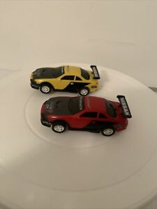 Pair of Artin Nissan 1/43 Scale Slot Cars