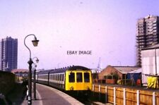 PHOTO  1985 TRAIN ARRIVING AT NORTH WOOLWICH A SUBURBAN DIESEL MULTIPLE UNIT ARR