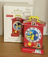 MINT Hallmark 2010 Fisher Price Music Box Teaching Clock School Motion Ornament