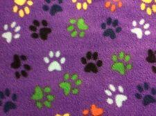 "colorful rainbow dog bear paw print on purple fleece fabric, 60"" wide, sold BTY"